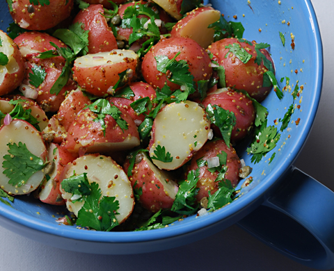 Served warm, this Potato Salad with Capers, Shallots and Mustard is ...